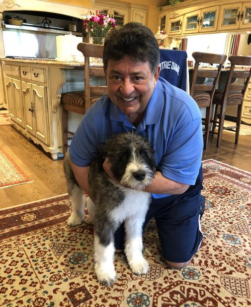 Edward DeBartolo past owner of the 49ers  with his new Saint Berdoodle puppy from Goliath Saint Berdoodles